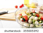 tasty salad in glass dish on... | Shutterstock . vector #355005392