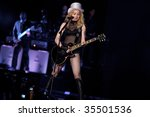 Small photo of MUNICH - AUGUST 18: Singer Madonna performs onstage at Olympic Stadium, 'Sticky & Sweet Tour' August 18, 2009 in Munich, Germany.