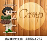 Boy With Glasses Climbing The...