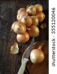 bunch of golden onion on dark...