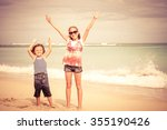 sister and brother playing on... | Shutterstock . vector #355190426