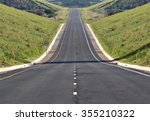 a highway stretches off into... | Shutterstock . vector #355210322