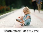 child sitting on path on summer ... | Shutterstock . vector #355219592