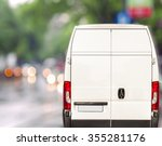 White Delivery Van Driving Fas...