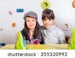 little girls sitting and... | Shutterstock . vector #355320992