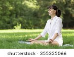 middle aged woman doing yoga... | Shutterstock . vector #355325066