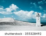 lighthouse and sand dunes by... | Shutterstock . vector #355328492