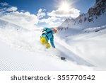 skier skiing downhill in high... | Shutterstock . vector #355770542