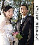 wedding couple holding flower... | Shutterstock . vector #35579176