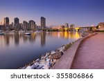 Stock photo the skyline of vancouver british columbia canada from across the water at dusk 355806866