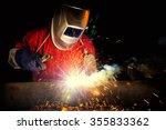 Welder Working A Welding Metal...