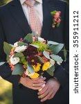 groom in a wedding suit holding ... | Shutterstock . vector #355911212