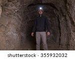 speleologist inside cave | Shutterstock . vector #355932032