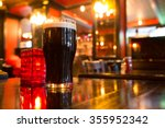 glass of dark beer with candle... | Shutterstock . vector #355952342
