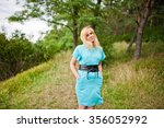 adult blonde woman posed at... | Shutterstock . vector #356052992