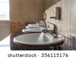 water flows from the tap in a... | Shutterstock . vector #356115176