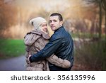 young attractive couple in love ... | Shutterstock . vector #356135996