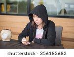 asian woman using mobile phone... | Shutterstock . vector #356182682