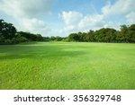 green grass field of public park | Shutterstock . vector #356329748