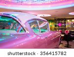 Bar Decorated By Old Pink Car...