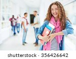 smiling girl with books looking ... | Shutterstock . vector #356426642