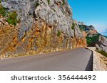 winding asphalt road in the... | Shutterstock . vector #356444492