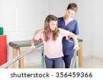 physical therapist with... | Shutterstock . vector #356459366
