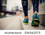 woman athlete feet and shoes... | Shutterstock . vector #356562575
