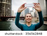 beautiful urban woman using a... | Shutterstock . vector #356562848