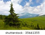 Nice mountain landscape with clouds - stock photo