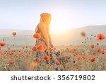 beautiful girl in a poppy field ... | Shutterstock . vector #356719802