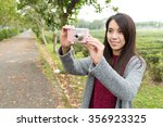 asian woman taking picture for... | Shutterstock . vector #356923325