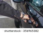 businessman is opening the door ... | Shutterstock . vector #356965382