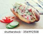 crab salad sandwich on wooden...