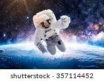astronaut over earth   elements ... | Shutterstock . vector #357114452