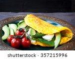 freshly cooked omelette filled... | Shutterstock . vector #357215996