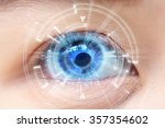 close up of woman's blue eye.... | Shutterstock . vector #357354602