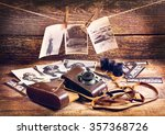 retro camera and old photos on... | Shutterstock . vector #357368726