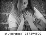 mother protecting child | Shutterstock . vector #357394502