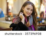young beautiful woman in a... | Shutterstock . vector #357396938