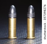Small photo of Cartridges that are designed to be used in rimfire twenty twos