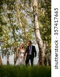 young wedding couple on summer... | Shutterstock . vector #357417665
