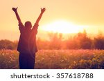 cheering woman open arms at... | Shutterstock . vector #357618788
