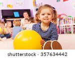 little girl with ball sit in... | Shutterstock . vector #357634442