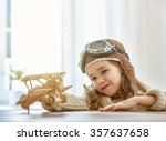 happy child girl playing with... | Shutterstock . vector #357637658