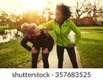 two sportswomen relaxing after...   Shutterstock . vector #357683525