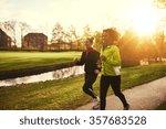 two sportswomen running in park.... | Shutterstock . vector #357683528