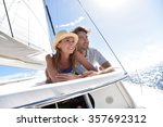 couple laying on a sailboat... | Shutterstock . vector #357692312
