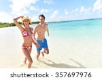 cheerful couple running on a... | Shutterstock . vector #357697976