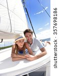 couple laying on a sailboat... | Shutterstock . vector #357698186